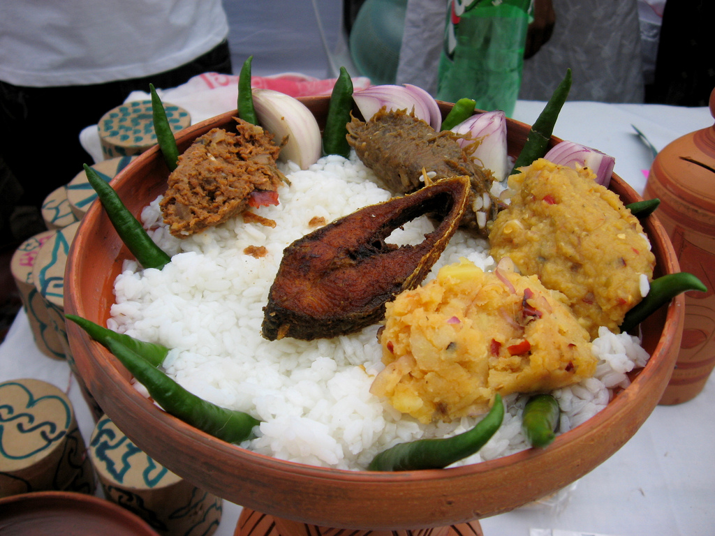 Panta Ilish – a traditional platter of Panta bhat, with fried ilish slice, supplemented with dried fish (shutki), pickles (achar), dal, chillies, and onion – is a popular dish during the Pohela Boishakh festival.