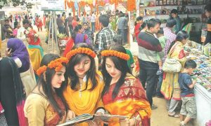 Visitors gather in front of different book stalls on Bangla Academy premises